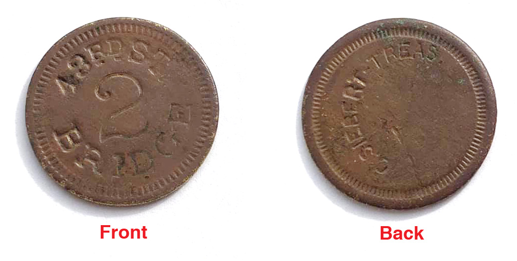 Front and back views of a token for the 43rd Street Bridge.